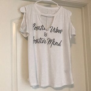 Jessica Simpson off the shoulder tee.
